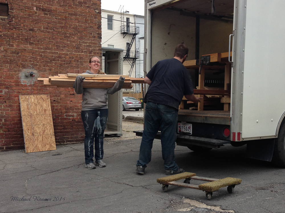 Unloading the truck wood and our work benches